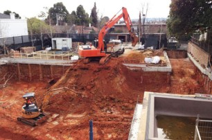 Excavation of 12 car underground garage.