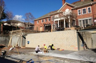 Retaining wall between garage and home.